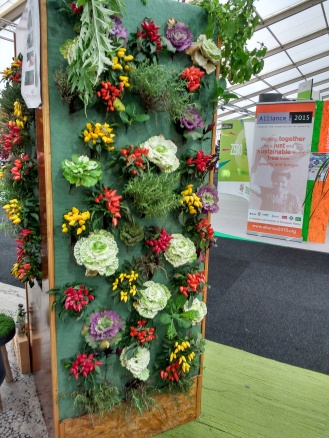 "While there were indeed cases highlighted by media of ""false solutions"" and ""greenwashing"" at COP21, the CGA showcased many ideas (such as this food wall) which are practical and feasible for citizens to use today. Other highlights included attractive, sturdy furniture built from waste materials (""upcycled"") and new innovations in land/air/sea monitoring using autonomous/semi-autonomous machines, powered independently for long-range and low-emission data collection."